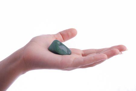 aventurine: Hand holds aventurine - semiprecious gems are  used in esoteric and alternative medicine Stock Photo