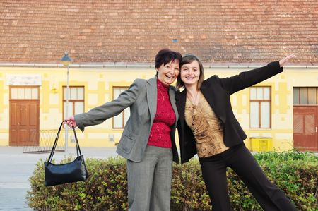 Mature woman has happy time with her daughter on street Stock Photo - 3827009