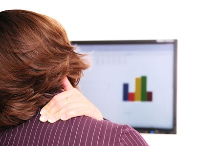 Business person with neck pain behind computer monitor Stock Photo - 3827011