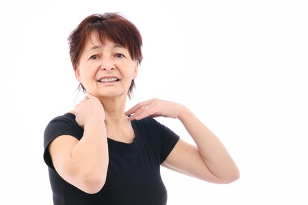 Senior woman with neck pain photo