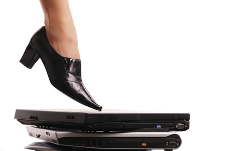 Leg of business woman stepping on computers - isolated Stock Photo - 4234702