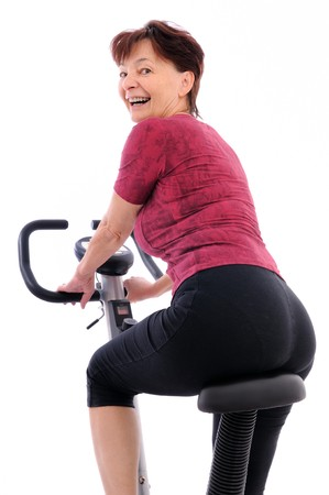 over shoulders: Spinning senior woman - back view
