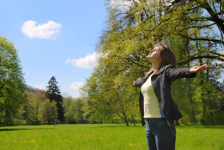 Woman is  enjoying her life  among trees on spring sun outdoors in park Stock Photo - 4208787