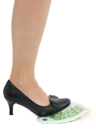 under control: Leg on banknotes (money under control - concept) Stock Photo