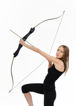 Beautiful kneeling woman aiming with bow and arrow Stock Photo - 4266601