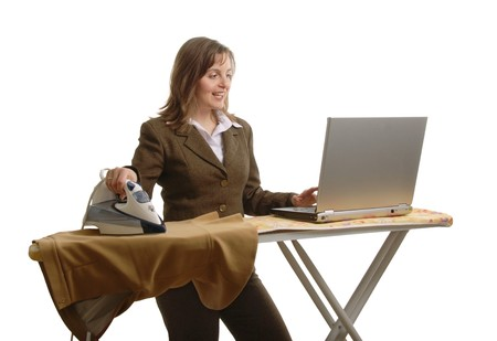 the emancipation: Young attractive and smiling  bussiness woman working with laptop and iron Stock Photo
