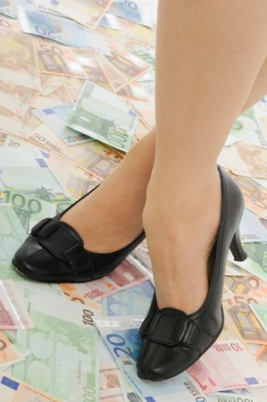 under control: Crossed legs on banknotes (money under control and security concepts)