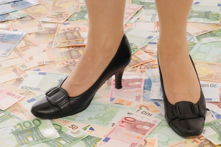 under control: Legs in elegant shoes on euro banknotes (money under control and security concepts) Stock Photo