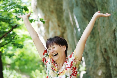 Senior woman enjoys life outdoors Stock Photo - 4330794