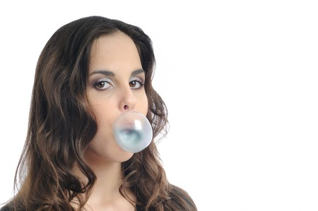 Beautiful teenage girl (woman) making bubble with chewing gum isolated - face detail