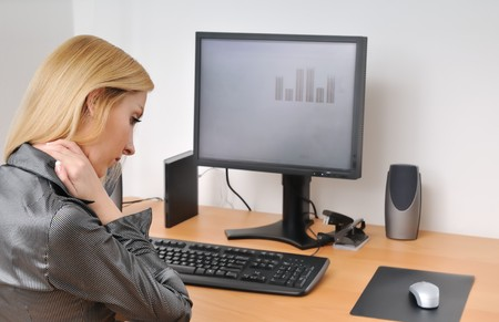 Business woman with neck pain on workplace Stock Photo - 4438671