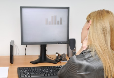 Business woman with neck pain sitting at computer Stock Photo - 4438675