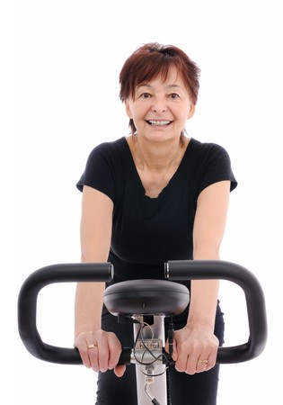Spinning - smiling senior woman - isolated Stock Photo - 4534222