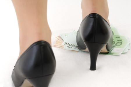 under control: Leg on banknotes (money under control - concept) - rear view