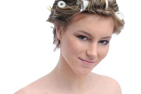 haircurlers: Young beautiful woman with hair rollers in curls isolated on white Stock Photo