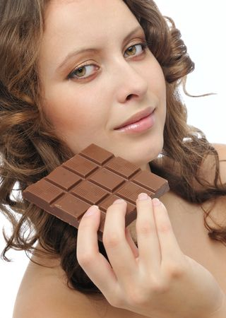 Young beautiful smiling woman eating milk chocolate isolated on white background Stock Photo - 4631665