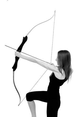 Beautiful woman aiming with bow - studio shot photo