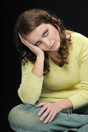 Young beautiful woman (teenager) in depression isolated on black background Stock Photo - 4844009