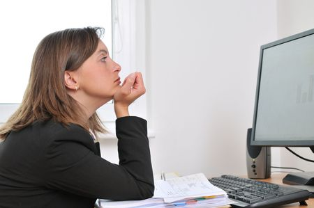 Tired and bored young business woman in depression sitting at computer on workplace Stock Photo - 5237262