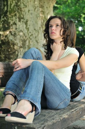 Friends outdoors series - two teenage girls are in conflick and do not speak with each another Stock Photo - 5237263