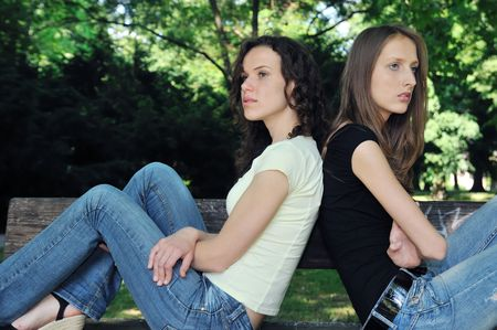 Friends outdoors series - two teenage girls are in conflick and do not speak with each another Stock Photo - 5237278