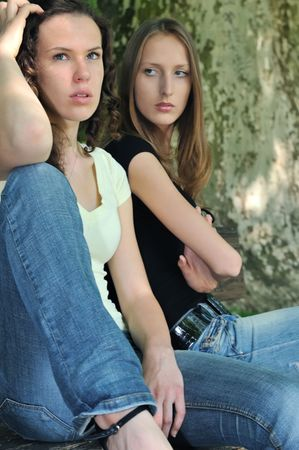 Friends outdoors series - two teenage girls are angry due to ther conflict Stock Photo - 5237291