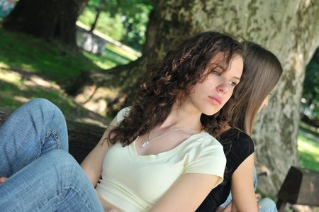Friends outdoors series - two teenage girls are angry due to ther conflict Stock Photo - 5404112