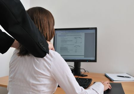 Business working person (woman) behind computer receiving neck massage from colleague (rear view with hands) Stock Photo - 5509462