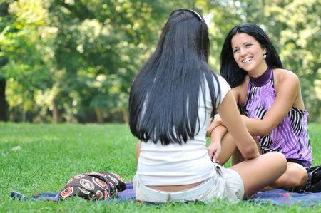 Youth lifestyle series - two young friends talking outdoors in park. Stock Photo - 5509467