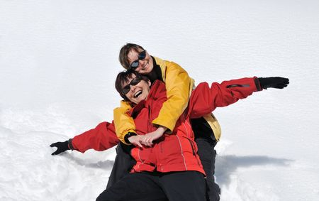 Mature senior woman has happy time with her daughter on fresh white snow in winter season Stock Photo - 5509463