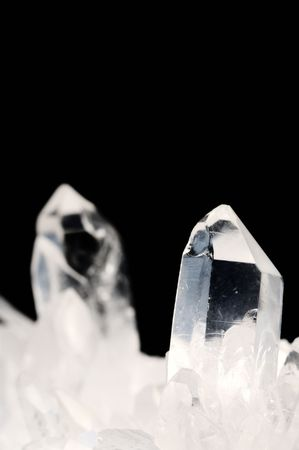 Quartz crystals on black background with copy space photo