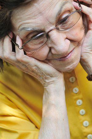 Solitude - portrait of worried senior woman              photo