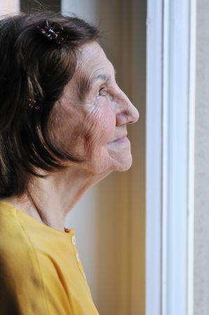Strange Solitude Concept Sad 80S Senior Woman Looking Through Window Hairstyles For Women Draintrainus