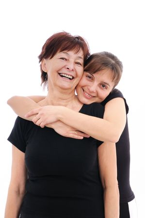 embracement: Happy senior woman with her smiling daughter