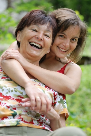 Senior people series - detail of mature woman spending happy time with her daughter outdoors Stock Photo - 5591648