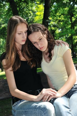 Friends series - one teenage girl comforts another which has serious problem Stock Photo - 5626811
