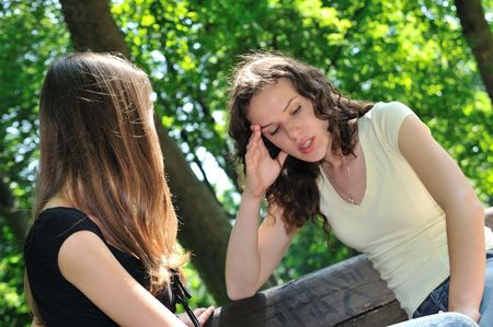 serious woman: Friends series - one teenage girl comforts another which has serious problem