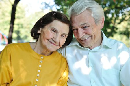 elderly couples: Portrait of happy senior man and woman outdoors in park      Stock Photo