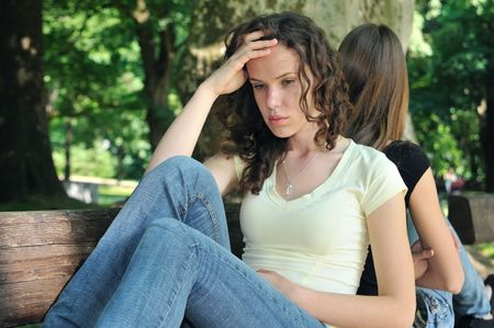 Friends outdoors series - two teenage girls are in conflick and do not speak with each another Stock Photo - 6448128