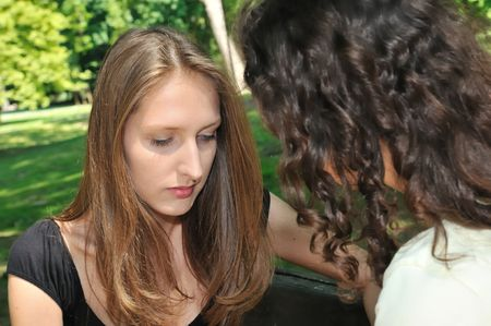 Friends series - one teenage girl comforts another which has serious problem Stock Photo - 6448120