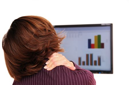 Business person with neck pain behind computer monitor Stock Photo