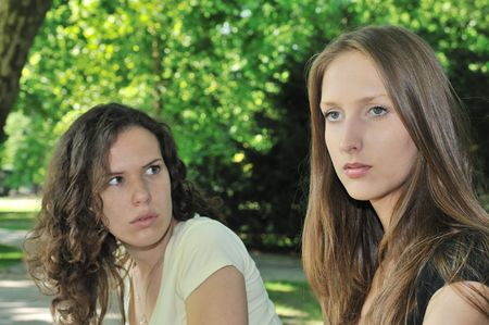 Friends outdoors series - one girl is offended and  second wants make a peace Stock Photo - 6672942