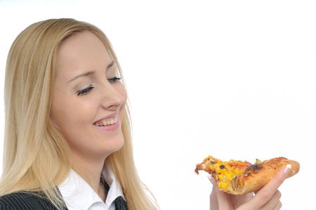 Young cheerful business woman looking on pizza slice photo