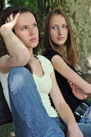 Friends outdoors series - two teenage girls are angry due to ther conflict photo