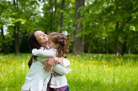 joy of life: Small girl enjoying life with her mother outdoors