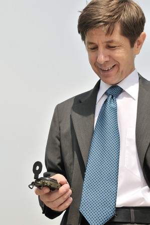 Senior people series - portrait of mature business man looking at compass with copy space Stock Photo - 7221140