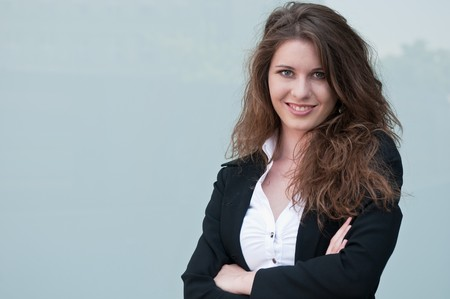 Young smiling business woman - portrait against plain glass background Stock Photo - 7565251