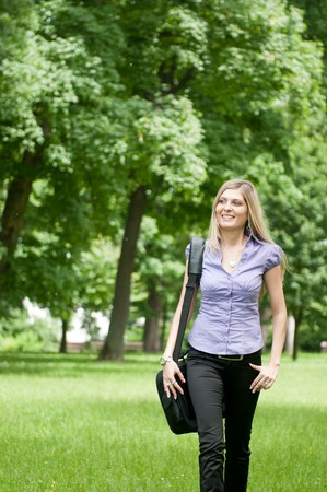 Young business woman wit laptob bag walking outdoors in park Stock Photo - 7698970