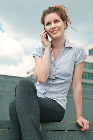 Young beautiful smiling woman calling with mobile phone Stock Photo - 7699686