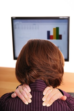 neck pain: Business womanwith neck pain holds her neck with both hands